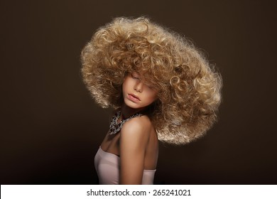 Glamor. Classy Gorgeous Woman with Curly Permed Hairs