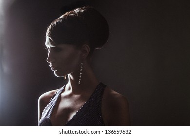 glamor portrait of beautiful sexy stylish Caucasian young woman on black with bright makeup. evening style