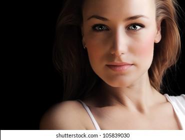Glamor woman face dark portrait, beautiful female isolated on black background, stylish sexy look, young lady studio shot