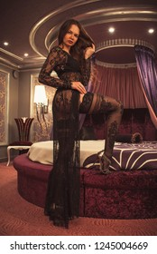 Glamor woman in transparent clothes at bedroom