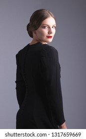 Glamorous 1930s woman in black dress