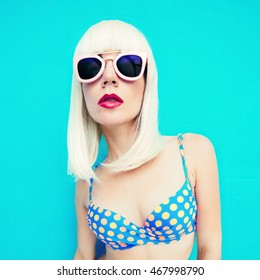 Glamorous Blonde Bob on a blue background. Summertime style and Fashion.