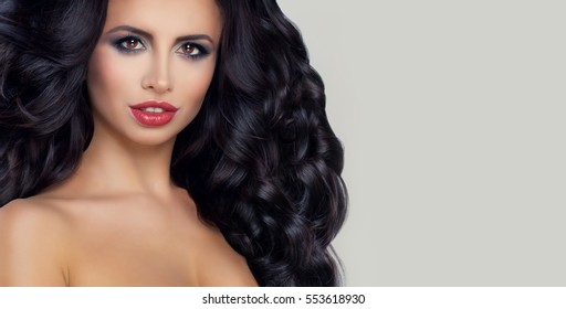 Glamorous Brunette Woman with Curly Hair and Fashion Makeup on Banner Background