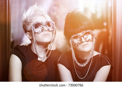 glamorous caucasian girls with stylish shades with chains