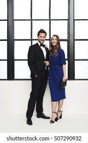 Glamorous couple in formal clothing, portrait