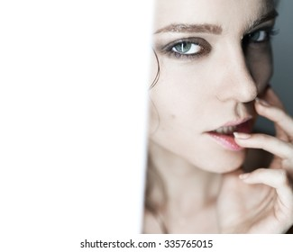 Glamorous fashion close-up portrait of a girl in a studio with a clean skin
