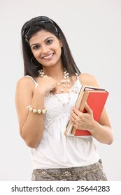 glamorous girl with books
