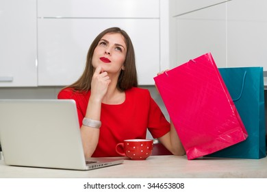Glamorous housewife shopping online at her laptop