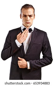 Glamorous male model in white shirt, black jacket, and bow-tie.