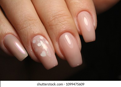 glamorous manicure of nails on beautiful female hands