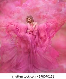 Glamorous photo. Girl in pink air dress.