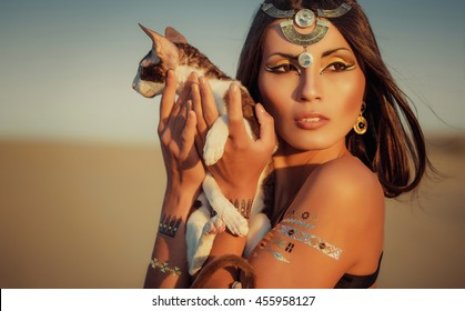 Glamorous  portrait of beautiful sexy  brunette woman model with Flash Tattoo. Cleopatra. Shooting outdoors in the style of ancient Egypt.