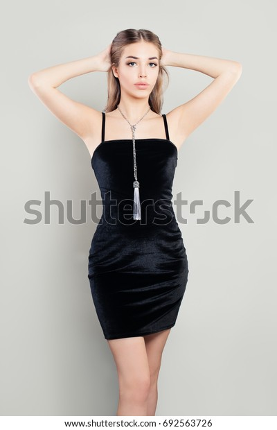 Glamorous Prom Girl Fashion Model in Black Dress. Fashion Portrait