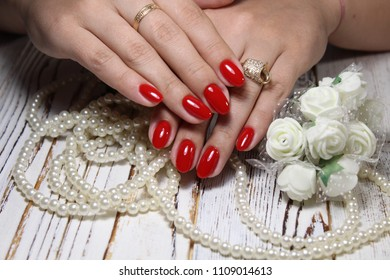 glamorous red manicure on beautiful female hands