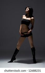 glamorous style of asian female model in dramatic lighting