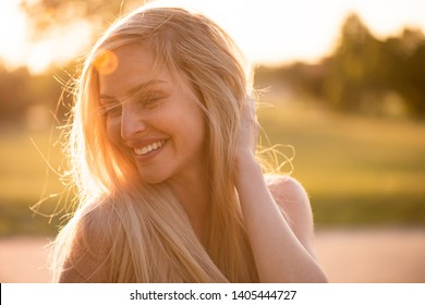 Glamorous stylish woman with long golden silky hair
