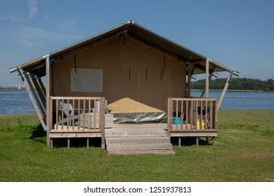 Glamorous tent with wooden flooring, equipped and ready for guests