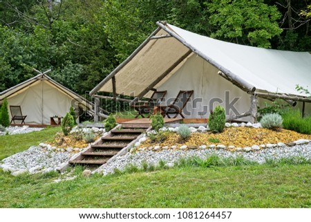 Glamorous tent with wooden flooring equipped and ready for guests in Bovec Slovenia. & Glamorous Tent Wooden Flooring Equipped Ready Stock Photo (Edit Now ...