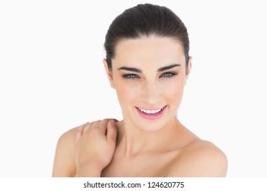 Glamorous woman looking at camera while smiling