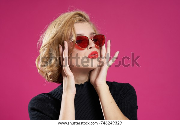 glamorous woman in sunglasses on a pink background, glamor, portrait