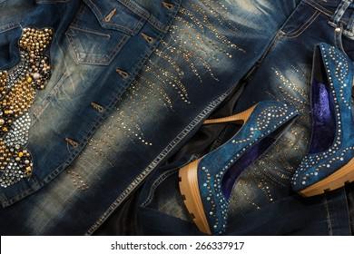 Glamorous women's fashion, jeans, shoes, jacket in rhinestones