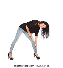 Glamorous young woman in black jacket and jeans on white background, studio