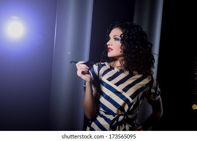 Glamorous young woman in the colored dress glamorous
