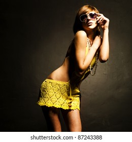 Glamorous young woman in sunglasses