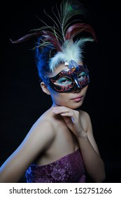 glamour asian woman with mask in photography studio