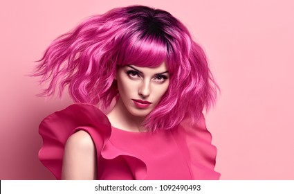 Glamour Beautiful Lady. Party Fashion Hairstyle. Woman in Pink Summer Dress. Young Playful Model in Stylish Outfit. Creative Art Studio Concept Girl fashionable Portrait. Trendy, fun