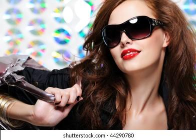 glamour beautiful young woman with fashion sunglasses and handbag