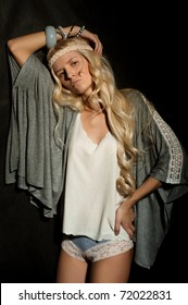 The glamour blond girl on a gray background