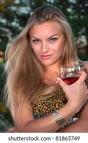 The glamour  blonde woman  with a glass