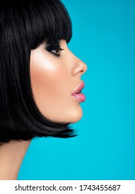 Glamour fashion model with black gloss make-up. Beautiful fashion woman with a bob hairstyle. Attractive white girl with black eye-makeup.  Stylish fashionable concept. Art.