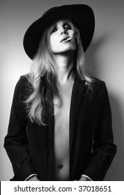 Glamour fashion shot of sexy female model in black and white smoking