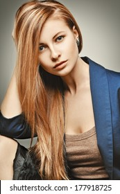 Glamour Fashion Woman portrait. Glamourous model with magnificent hair in a blue business suit.