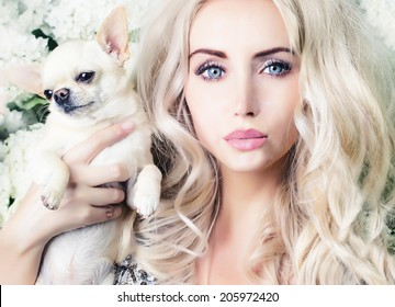 glamour girl holding small dog