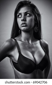 Glamour monochrome toned portrait of a beautiful young lady  with bra