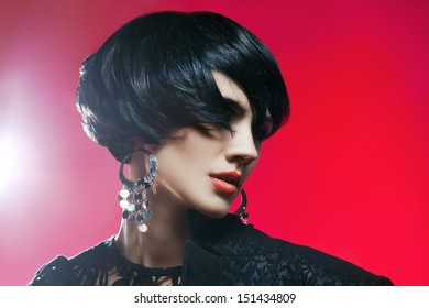 Glamour portrait of beautiful fashion model  in Black Dress posing with exclusive jewelry. Professional makeup and hairstyle
