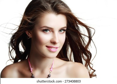 Glamour portrait of beautiful woman model with fresh daily makeup and romantic wavy hairstyle. Fashion shiny highlighter on skin