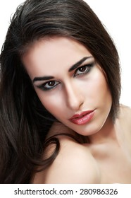 Glamour portrait of beautiful woman model with green smoky makeup and dark hair