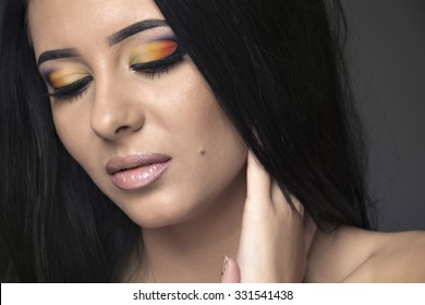 Glamour portrait of beautiful woman model with fresh daily makeup and romantic wavy hairstyle