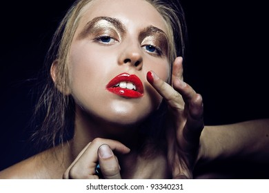 Glamour portrait of beautiful woman model with beautiful make up on dark background