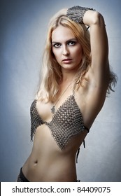 Glamour portrait of beauty fashion woman in chain armour