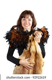 glamour portrait of  girl in feathers clothes  girl with fox fur