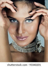 Glamour portrait of sexy beautiful young woman with deep blue eyes