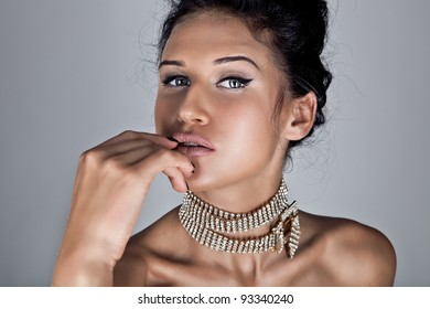 Glamour portrait of sexy beautiful young woman posing on grey background
