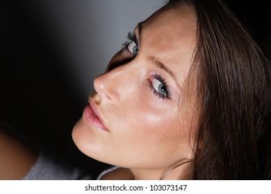 Glamour Portrait of sexy woman on dark background