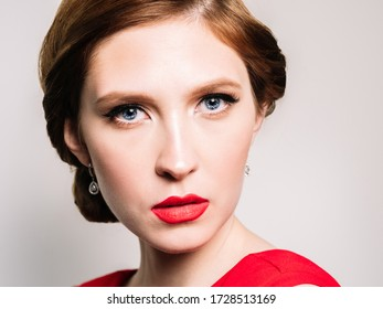 Glamour retro  portrait of beautiful woman  with  stylish makeup and red lipstick