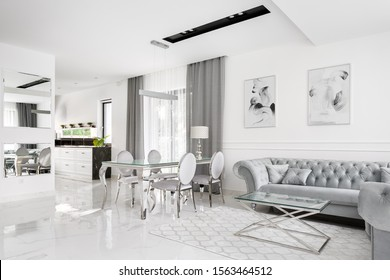 Glamour and romantic style home interior with kitchen open to living room with big dining table